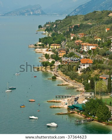 The beautiful coastline of Malcesine on Lake Garda in northern Italy - stock photo