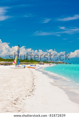 The beautiful cuban beach of Varadero with sailing boats, white sand and cristal clear turquoise water - stock photo