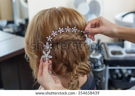 The beautiful decorations in the head. Wedding accessories. Female jewelry for girls. Details for marriage and for a married couple