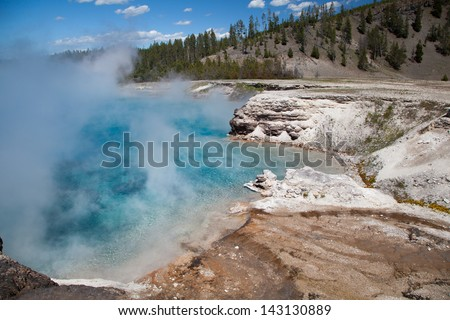 The beautiful Excelsior Geyser Crater hot spring in Midway Geyser Basin at Yellowstone National Park, Wyoming. USA. - stock photo