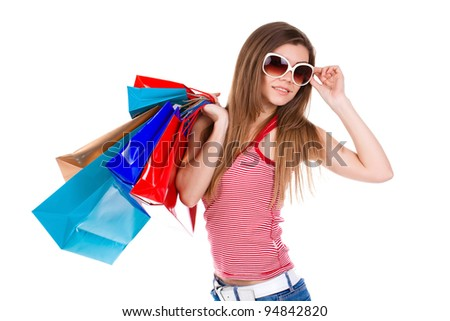 The beautiful fashionable stylish European woman with purchases in hands after a campaign in shops. Full portrait on a white background.