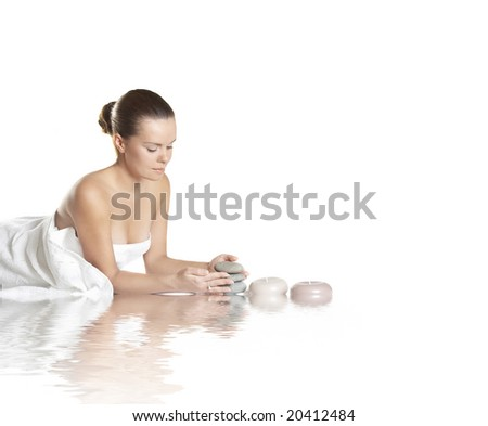 The beautiful girl about aroma by candles - stock photo