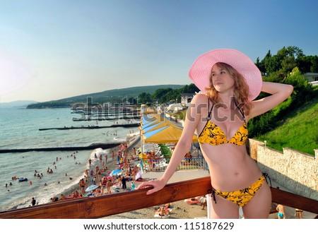 The beautiful girl against the Black Sea beach. Divnomorsky. Russia - stock photo