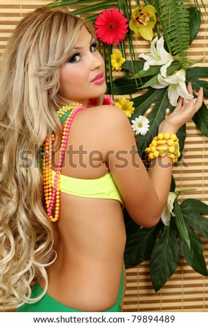 The beautiful girl and flowers - stock photo