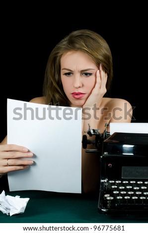 The beautiful girl at a typewriter. Retro - stock photo