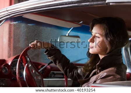 The beautiful girl at the wheel the retrocar