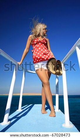 The beautiful girl costs aft yachts - stock photo