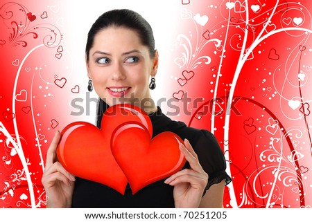 The beautiful girl costs with heart in hands symbolizing day of  Valentine - stock photo