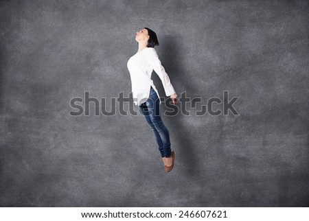 The beautiful girl flies highly in a jump - stock photo