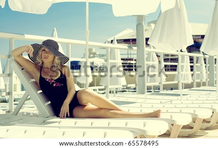 The beautiful girl has a rest on the yacht - stock photo