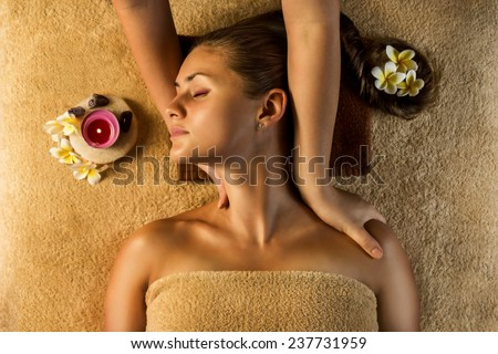 The beautiful girl has massage. Stretching masage moves. - stock photo