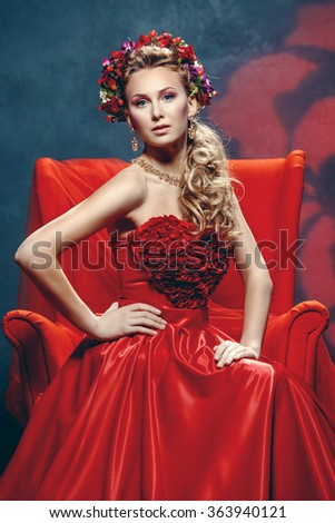 The beautiful girl in a red dress
