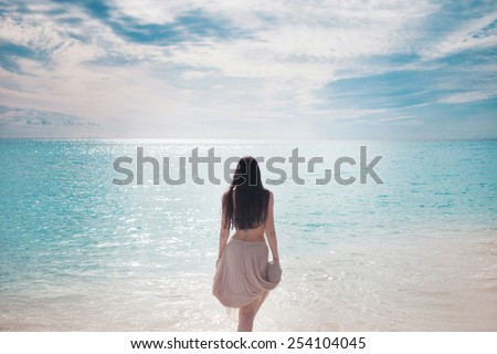 The beautiful girl in blue bikini.  - stock photo