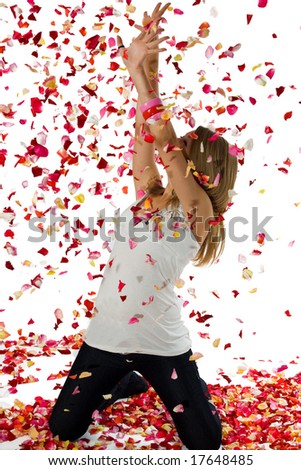 The beautiful girl in the rain from petals of roses - stock photo