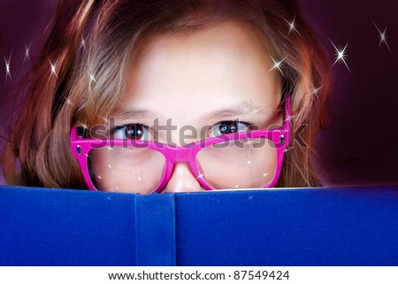 The beautiful girl reads the book. - stock photo