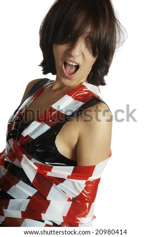The beautiful girl, untangles a red tape - stock photo