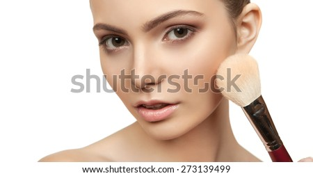 The beautiful girl with a make-up in Spa salon after cosmetic procedures holding a tool for makeup - stock photo
