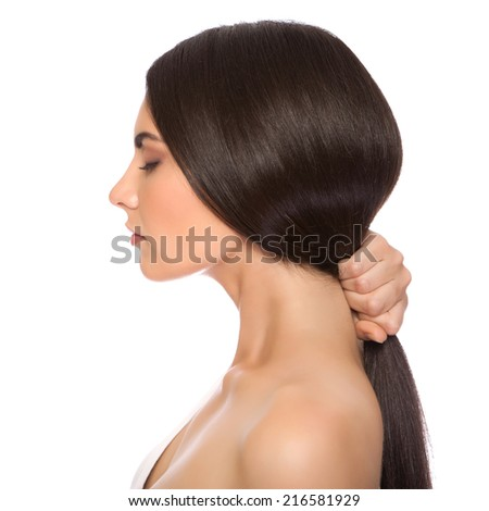 The beautiful girl with a make-up in Spa salon after cosmetic procedures keeps hair - stock photo