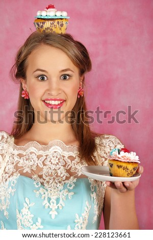 The beautiful girl with a smile holds piece of cake - stock photo