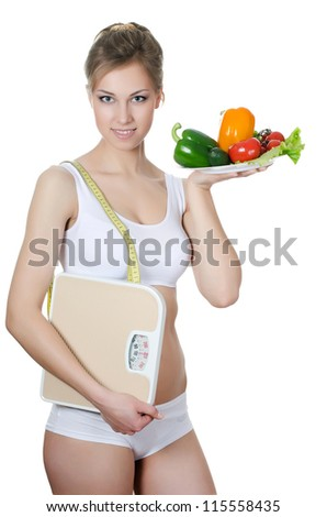 The beautiful girl with plate with vegetables - stock photo