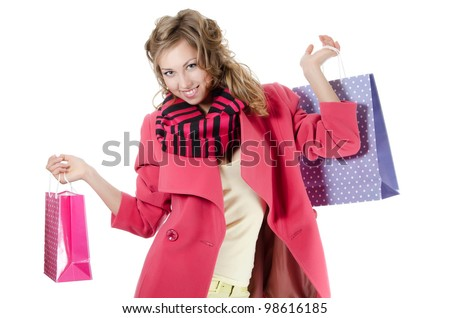 The beautiful girl with purchases - stock photo