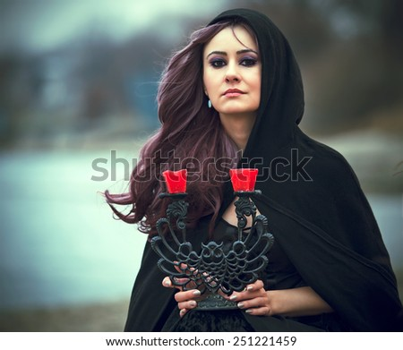 The beautiful gothic girl - stock photo