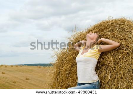 The beautiful joyful girl runs on a field - stock photo
