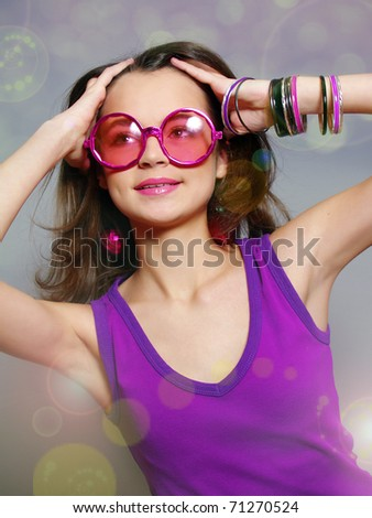 The beautiful laughing girl in round pink sun glasses