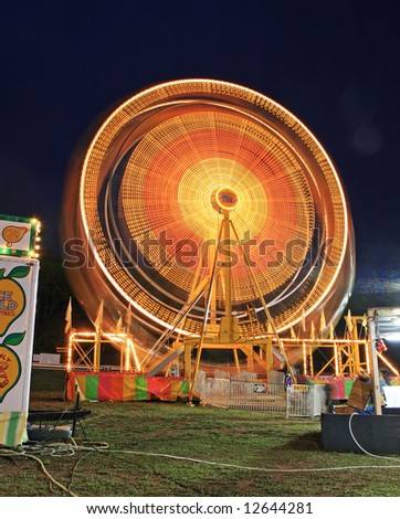 The beautiful light trails at night in a county carnival in New Jersey - stock photo