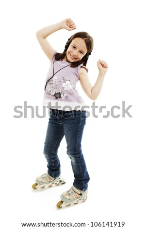 The beautiful little girl with earphones in roller skates. Isolated on a white background - stock photo