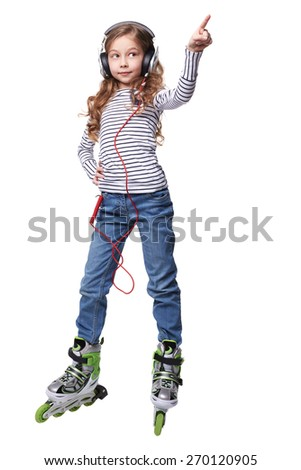 The beautiful little girl with earphones in roller skates on a white background. - stock photo