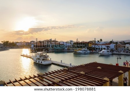 The beautiful Marina in Limassol city in Cyprus. A very modern, high end and newly developed area where yachts are moored and it's perfect for a waterfront promenade. The commercial area at sunset. - stock photo