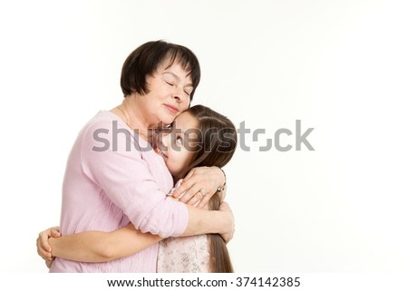 the beautiful mature woman embraces the granddaughter