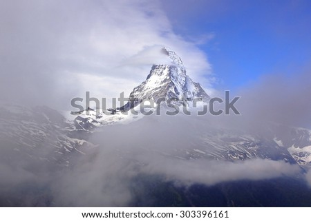 The beautiful mountain landscape with clouds. Switzerland. - stock photo