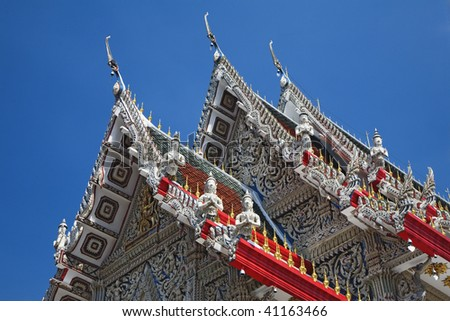 The beautiful ornate rooftop of Wat Suan Plu in Bangkok, Thailand. - stock photo