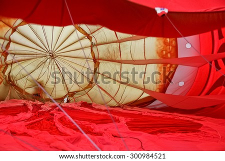 The beautiful pattern inside a hot air balloon viewed as it is being inflated. - stock photo