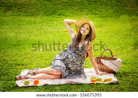 The beautiful pregnant woman in a dress on picnic - stock photo
