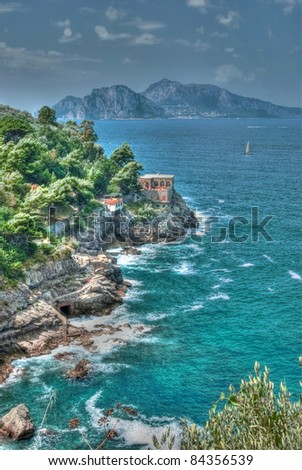 The beautiful rugged coastline of Sorrento with the island of Capri in the background in  Italy - stock photo