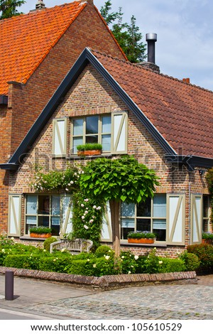 The beautiful rural, brick house in the Dutch style