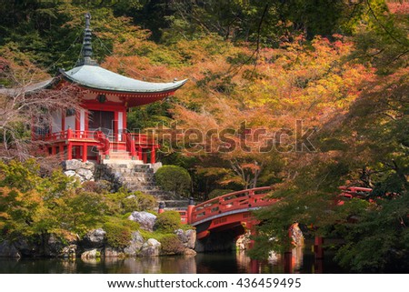The beautiful scene of Bentendo hall on a sunny day of early autumn, it is surrounded with Maple and Cherry Blossom. This hall is located in Daigoji Temple, Kyoto, Japan. - stock photo