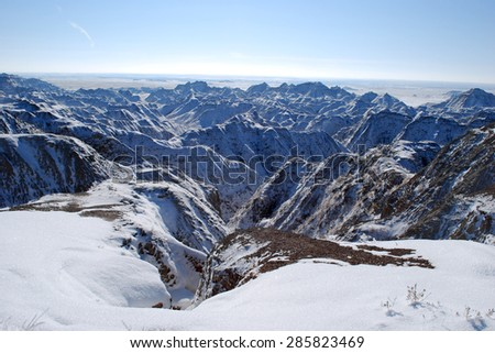 The beautiful scenic view of Badlands covered with snow in November - stock photo