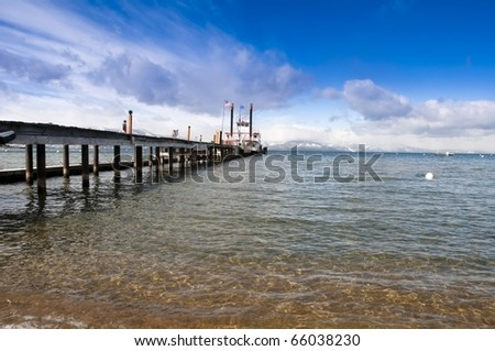 The beautiful shores of Lake Tahoe with a steamboat and pier - stock photo