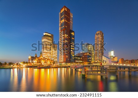 The beautiful skyline with modern buildings of Rotterdam at night