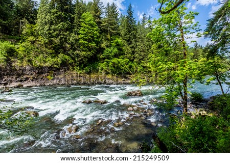 The Beautiful Snoqualmie River Near the Snoqualmie Waterfall in the Great Pacific Northwest, USA.  River Basin View. - stock photo
