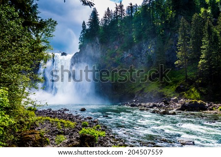 The Beautiful Snoqualmie Waterfall in the Great Pacific Northwest, USA.  River Basin View. - stock photo