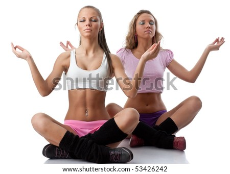 The beautiful sports girl does exercises on a white background. Fitness. - stock photo