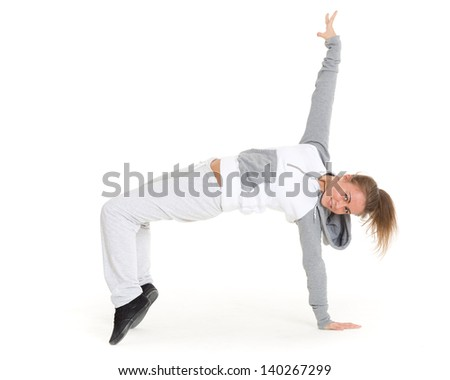 The beautiful sporty girl dancing on a white background. Modern dances. - stock photo
