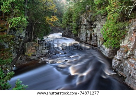 The Beautiful Sturgeon River Gorge, It's Golden Colored Rushing Water Made silky By This Early Morning Long Exposure, Upper Peninsula, Michigan, USA - stock photo