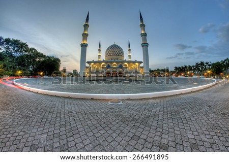 The beautiful Sultan Salahuddin Abdul Aziz Shah Mosque, Selangor, Malaysia. Image has grain or blurry or noise and soft focus when view at full resolution.  (Shallow DOF, slight motion blur) - stock photo