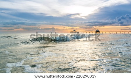 The beautiful sun setting on the shores of Fort Myers Beach located on Estero Island in Florida, United States of America - stock photo